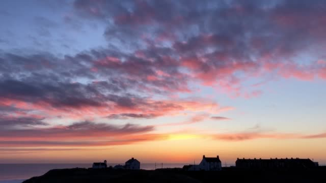 stockvideo's en b-roll-footage met footage of of the sunrise over the st mary's wynd in seaton sluice whitley bay the bay is located on the north coast of england - whitley bay