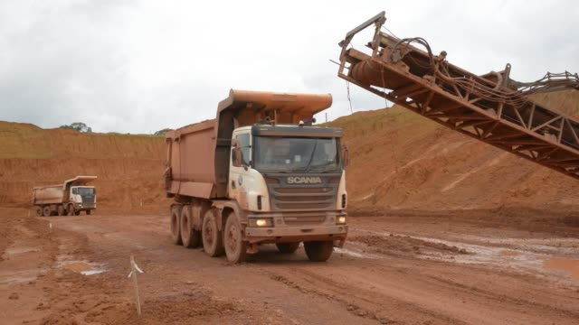 footage of paragominas bauxite mine on april 13 2016 in belem para brazil shots wide shot of hills as excavators work the land footage of trucks... - belém brazil stock videos and b-roll footage