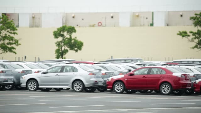 Footage of pedestrians traffic and the city of Nagoya Aichi Prefecture Japan on Tuesday June 9 2015 Shots wide shot of Mitsubishi Motors Corp...