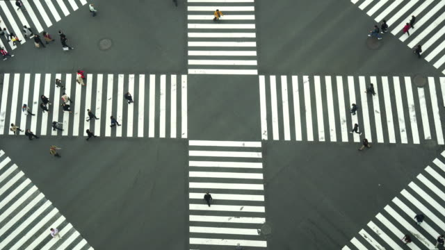 4k footage of people and car crowd with areial view pedestrains intersection cross-walk ginza crosswalk car traffic on tokyo city - zebra crossing stock videos & royalty-free footage
