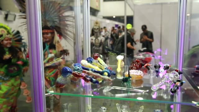 footage of people attending expoweed the first cannabis fair in mexico city mexico on august 12 2016 shots view of people taking pictures of dancers... - ボング点の映像素材/bロール