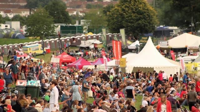 footage of people crowding at balloon fiesta and festival at ashton court, bristol uk. no audio - お祭り好き点の映像素材/bロール