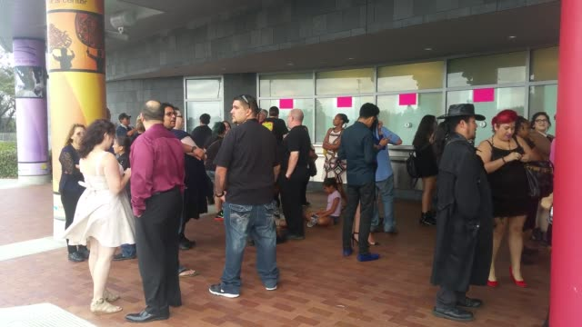 Footage of people waiting to get in the line to the WWE star Chyna's Memorial