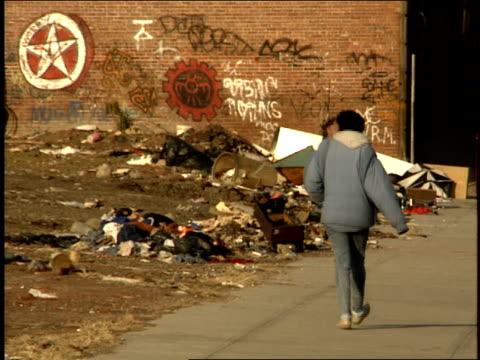 vídeos y material grabado en eventos de stock de footage of person walking down street - terrenos a construir