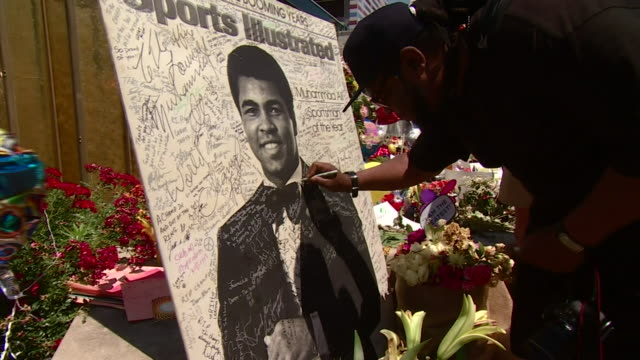footage of pictures photos and other tributes in louisville kentucky to the late boxer muhammad ali nnpw681j - death stock videos & royalty-free footage
