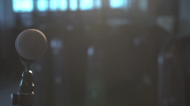 4k footage of planning microphone from right to left over the spot light in music room - microphone stock videos and b-roll footage