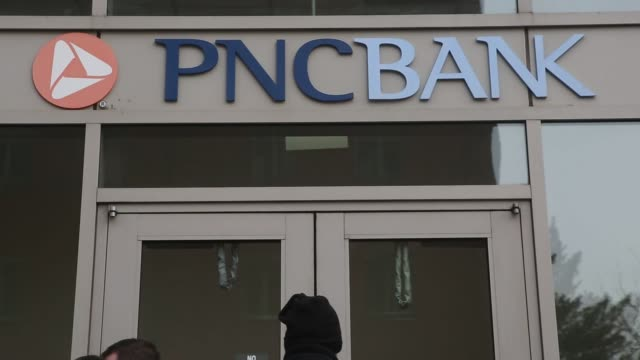 Footage of PNC bank locations in New York NY on January 9 2017 Shots wide shot of PNC bank location as traffic pass by shot from sidewalk of PNC bank...