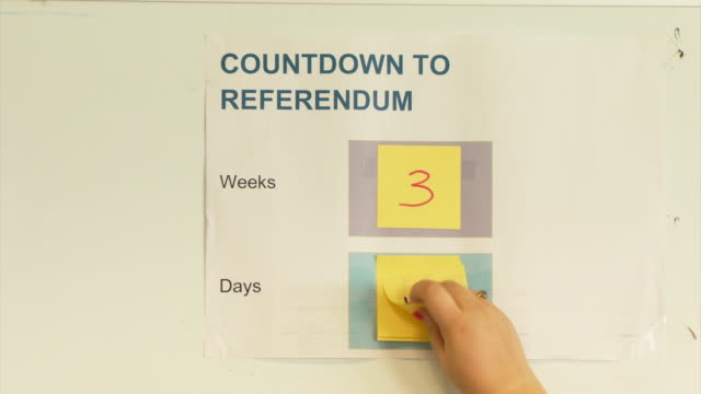 Footage of posters and sticky notes displaying the deadline for EU Referendum voter Registration NNBU048F
