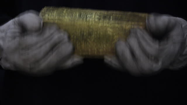 footage of precious metals with gold and silver being melted and poured into moulds plus gold and silver bullion being inspected and engraved at the... - financial item stock videos & royalty-free footage