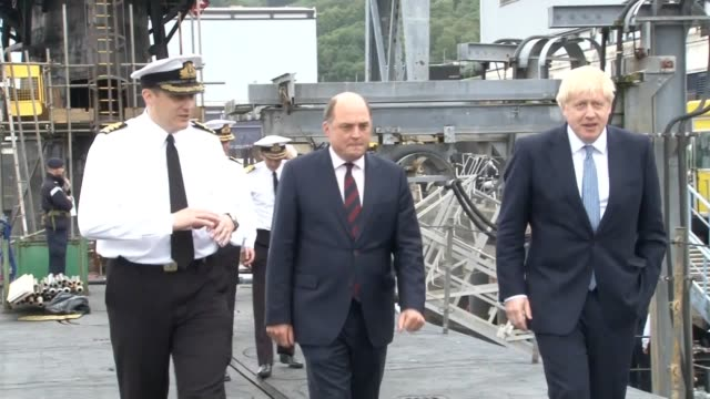 footage of prime minister boris johnson visiting hms victorious with defence secretary ben wallace accompanied by commander justin codd at hm naval... - 将校点の映像素材/bロール