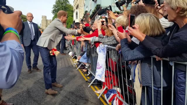 footage of prince harry and his best man the duke of cambridge greeting crowds in windsor the day before the wedding - prince harry stock videos and b-roll footage