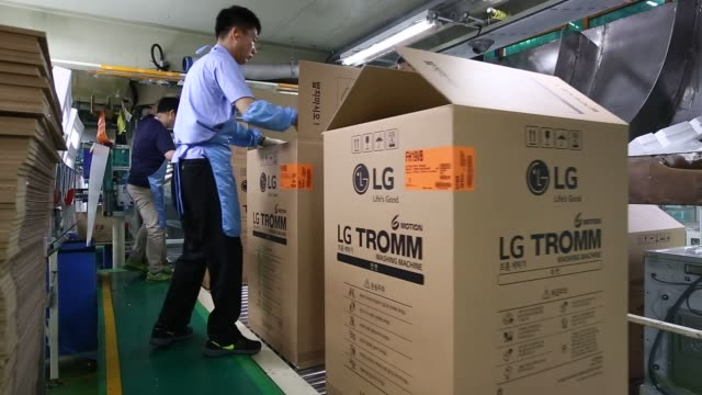 Footage of production at the LG Electronics Inc factory in Changwon South Korea on Thursday June 9 2016 Shots CU focus in to LG logo on washing...