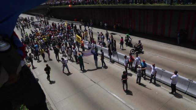 Footage of protests in Caracas Venezuela on Saturday April 4 2017 Shots footage of Venezuela flag being held up / high angle shot of protesters...