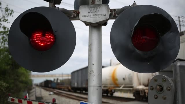 Footage of railroad crossing lights blinking in front of a track in Worthville Kentucky US on Monday April 17 2017