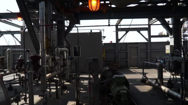 Footage of Reficar the newest refinery in Colombia in Cartagena Colombia on May 20 2016 Shots low angle shot of refinery tower lightbulbs and...