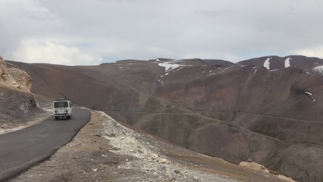 Footage of roads and POVs from vehicles in the surrounding area of Leh India on August 10 2015 Shots wide shot of road with sign covered in...