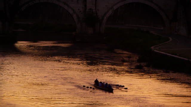 footage of rowing boat underneath bridge on the tiber river. - mystery stock videos & royalty-free footage