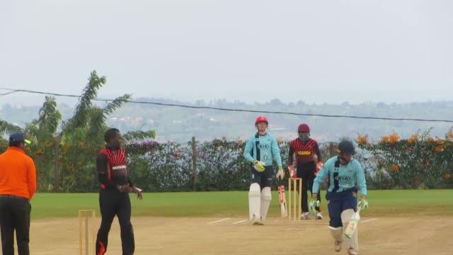 Footage of Sam Billings playing in Rwanda's new national cricket stadium and interviews with Rwanda's national team captains Eric Dusingizimana and...