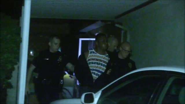footage of sdpd taking a burglary suspect into custody the suspect had a restraining order against someone in the house he broke through a patio door... - stehlen verbrechen stock-videos und b-roll-filmmaterial