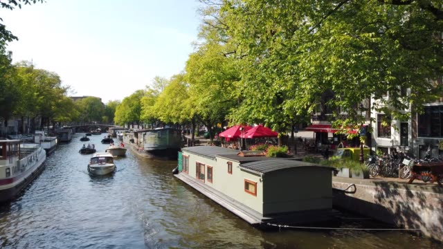 vidéos et rushes de footage of small boats on a canal in amsterdam, holland - culture néerlandaise