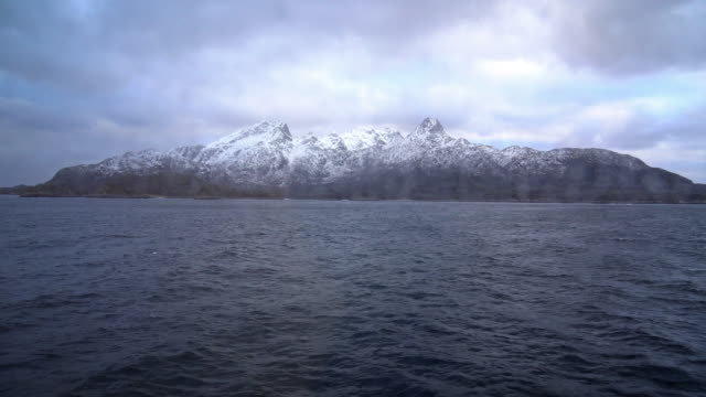 4K Footage of snow mountain look through from windows ferry boat, bodo city, norway