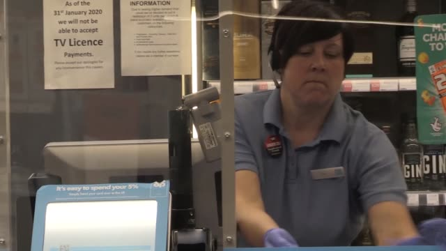footage of social distancing and other coronavirus precautions at a co-op shop in bromsgrove, worcestershire. includes shots of signage, two-metre... - groceries stock videos & royalty-free footage