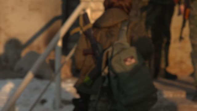 Footage of soldiers in an industrial region of Eastern Ukraine