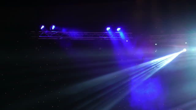 4K footage of stage tlight and spotlight concert moving over the dark background, entertainment and musical concept