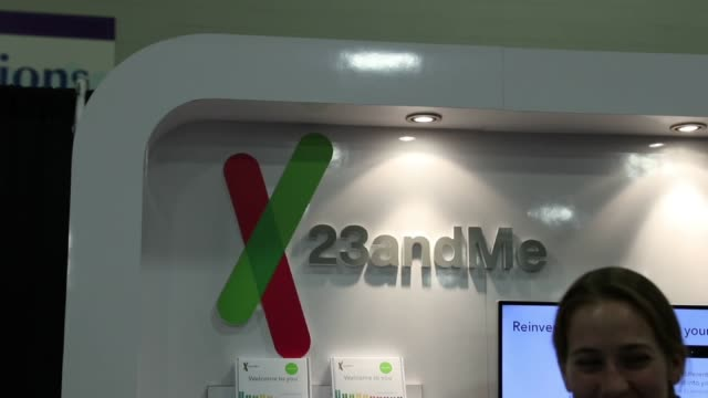 Footage of the 23andMe booth at the 2017 RootsTech Conference in Salt Lake City UT on February 9 2017 Shots employee assist attendee at laptop at 23...