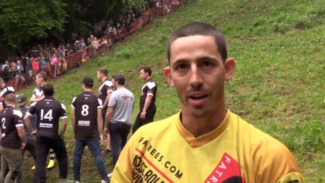 footage of the annual cheese rolling competition in brockworth gloucester and interviews with record holder chris anderson and nathan anstey from... - swimming trunks stock videos & royalty-free footage