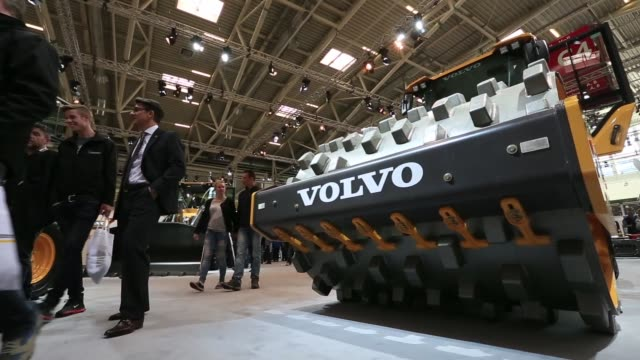 Footage of the Bauma construction industry fair in Munich Germany on Monday April 11 2016 Shots wide shot of excavator atop several large stones low...