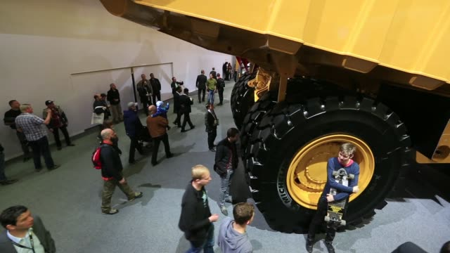 Footage of the Bauma construction industry fair in Munich Germany on Monday April 11 2016 Shots low angle shot of entrance to convention center with...