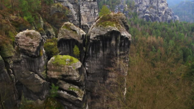 footage of the beautiful saxon national park in germany from viewpoint with stunning views of the rock formations with vertigo and adrenaline sensation. - one mid adult man only stock videos & royalty-free footage