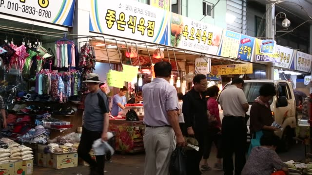 footage of the city and markets in busan south korea on saturday aug 1 2015 shots woman stands around with wagon full of potatoes in marketplace wide... - coffee drink stock videos and b-roll footage