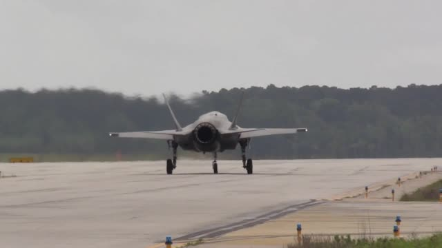 footage of the f35b lightning jets that are set to be used by the raf and royal navy in the coming years interviews with raf's wing commander scott... - 英国空軍点の映像素材/bロール