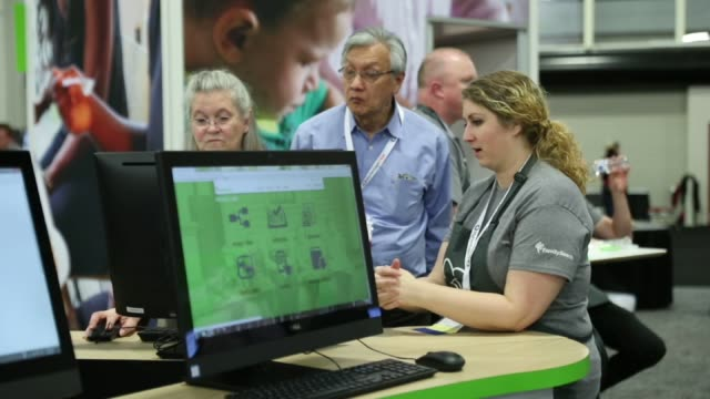 Footage of the FamilySearch booth at the 2017 RootsTech Conference in Salt Lake City UT on February 9 2017 Shots wide shot of FamilySearch booth with...