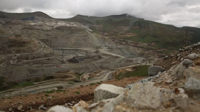 footage of the ferrobamba copper pit as mining trucks are loaded in cuzco peru on january 23 and 24 2017 shots pan general view of ferrobamba copper... - copper stock videos & royalty-free footage