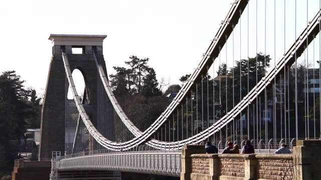 footage of the iconic clifton suspension bridge in bristol, uk, designed by isambard kingdom brunel. - suspension bridge stock videos & royalty-free footage
