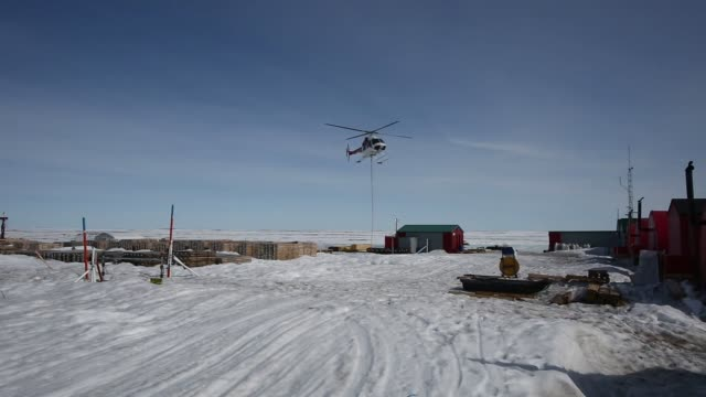 vidéos et rushes de footage of the kennady north diamond project in canadas northwest territories on may 4 2016 shots view of snow covered ground with shadow of airplane... - table top view