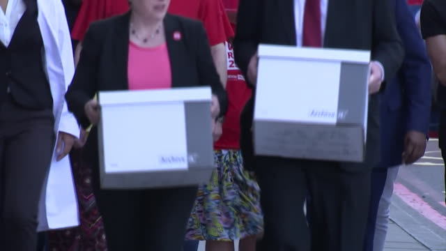Footage of the Labour team behind the Vote Remain campaign carry boxes of signatures NNBU047L