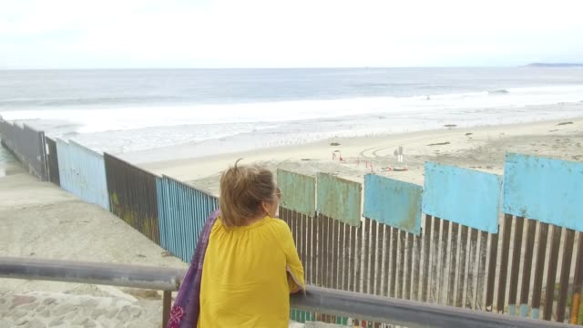 footage of the mexico/us border near a ledge on the shoreline of tijuana, mexico on october 31, 2017. photographer: dan acker - shots: wide pan left... - pair of compasses stock videos & royalty-free footage