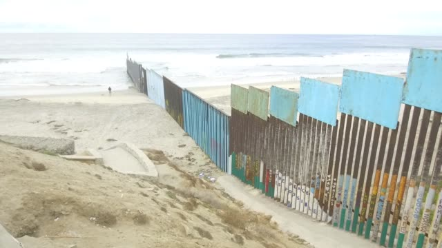 Footage of the Mexico/US Border viewed from ledge on the shoreline of Tijuana Mexico on October 31 2017 Photographer Dan Acker Shots wide pan left of...