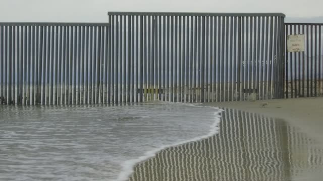 footage of the mexico/us border viewed from shoreline of tijuana mexico on october 31 2017 photographer dan acker shots wide shot of border on... - drawing compass stock videos & royalty-free footage