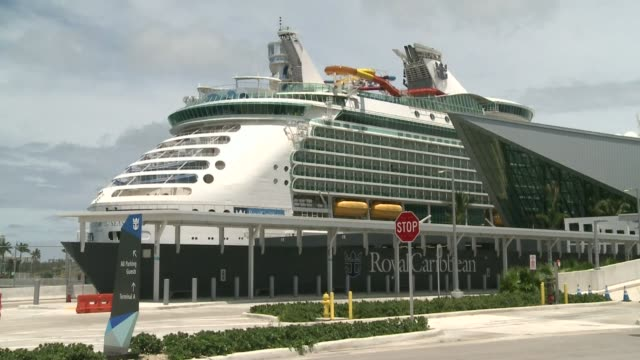 footage of the navigator of the seas, a cruise ship operated by royal caribbean international and docked in the port of miami, as a group of crew... - sailor stock videos & royalty-free footage