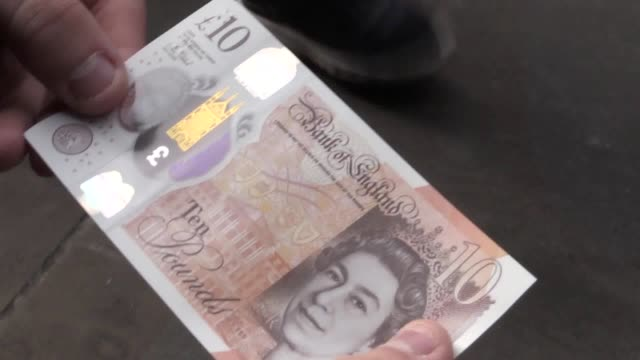 footage of the new £10 note which is synthetic material and features the author jane austen shots include people withdrawing notes and vox pops with... - jane austen author stock videos and b-roll footage
