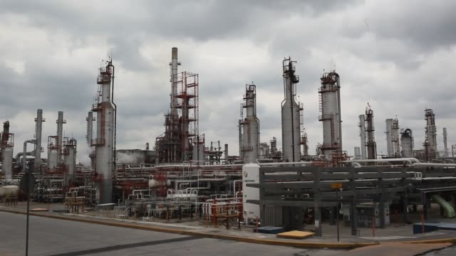 footage of the pemex refinery in obregón mexico on april 7 2016 shots wide shot of several large tanks view from vehicle passing parts of the... - 低い点の映像素材/bロール