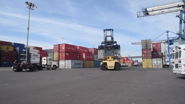 Footage of the Port of Philadelphia as gantry cranes and shipping vehicles move containers in Philadelphia Pennsylvania April 12 2017 Shots wide shot...