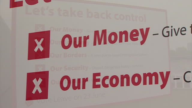 footage of the poster campaign outlining a manifesto for the vote leave campaign nnbw070k - poster stock videos & royalty-free footage