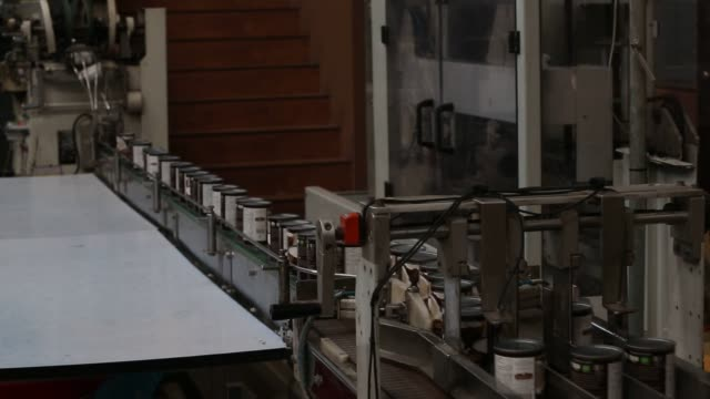 Footage of the production line of organic coconut milk from the raw coconut to the labeling and packaging and warehouse in Nongkangkok Chonburi...