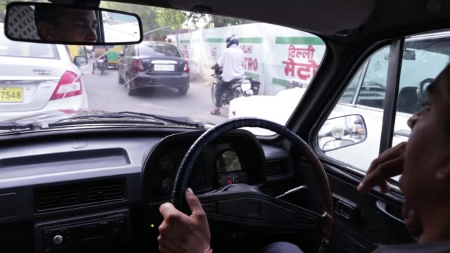 footage of the road from a hindustan motors ltd ambassador taxi and a rickshaw in new delhi india on saturday sept 19 2015 shots footage of the road... - rickshaw stock videos and b-roll footage